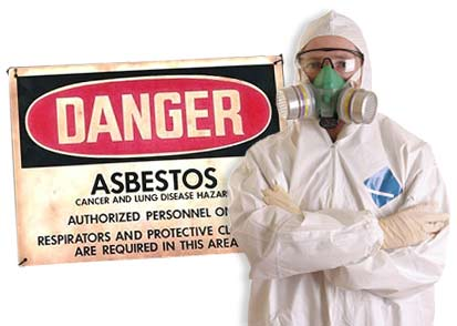 Asbestos Worker in full gear stands infront of warning sign that says Danger Asbestos